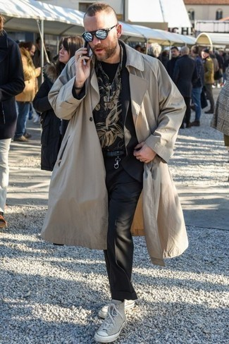 How to Wear a Black Print Crew-neck T-shirt For Men: A black print crew-neck t-shirt and a beige trenchcoat are the kind of a winning look that you so terribly need when you have no time. Play down the formality of this getup by finishing with beige canvas high top sneakers.