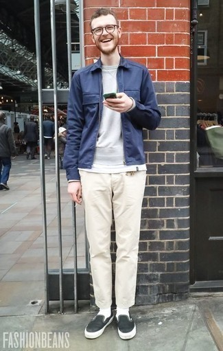 How to Wear a Navy Harrington Jacket: The pairing of a navy harrington jacket and beige chinos makes for a cool off-duty outfit. For maximum style effect, complete this look with a pair of black and white canvas slip-on sneakers.