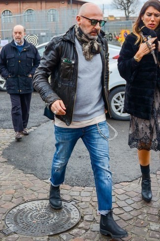 How to Wear a Grey Sweatshirt After 50 For Men: This laid-back combo of a grey sweatshirt and blue ripped jeans is effortless, stylish and extremely easy to copy. If you wish to instantly perk up your outfit with a pair of shoes, complete your getup with a pair of black leather chelsea boots.