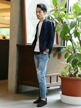 How to Wear Light Blue Ripped Jeans For Men: Team a navy blazer with light blue ripped jeans for an off-duty and stylish ensemble. Throw a pair of black canvas low top sneakers into the mix and you're all set looking killer.