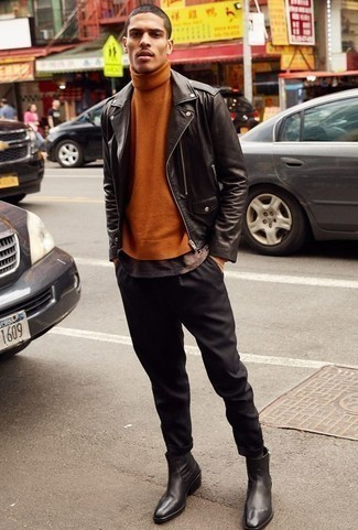 Men's Looks & Outfits: What To Wear In 2020: This combination of a black leather biker jacket and black chinos spells versatility and effortless menswear style. Hesitant about how to round off this look? Wear black leather chelsea boots to kick up the fashion factor.