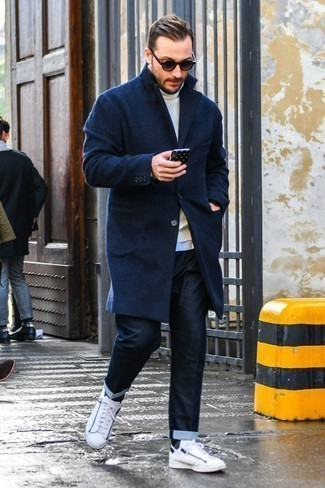 How to Wear a White Wool Turtleneck For Men: For a casually dapper ensemble, team a white wool turtleneck with navy jeans — these two items work perfectly together. On the footwear front, this look pairs perfectly with white leather low top sneakers.