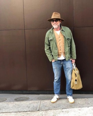 How to wear: blue ripped jeans, white crew-neck t-shirt, tan waistcoat, green field jacket