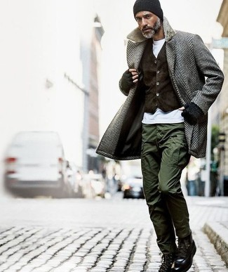 How to Wear Olive Cargo Pants In Winter: You'll be amazed at how super easy it is for any man to pull together this casually sleek ensemble. Just a grey herringbone overcoat worn with olive cargo pants. Look at how nice this ensemble is complemented with black leather casual boots. While it can be a bit of a conundrum to dress stylish on extra cold days, it's outfits like this that prove it's totally possible.