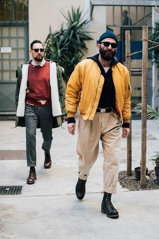How to Wear Black Leather Casual Boots For Men: You'll be amazed at how extremely easy it is for any man to throw together this casual getup. Just a yellow bomber jacket worn with beige chinos. Add a confident kick to the getup with a pair of black leather casual boots.