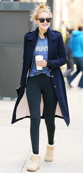 Women's Looks & Outfits: What To Wear In a Relaxed Way: This relaxed combination of a navy coat and black leggings is super easy to put together without a second thought, helping you look awesome and ready for anything without spending a ton of time digging through your wardrobe. Got bored with this outfit? Let beige uggs shake things up.