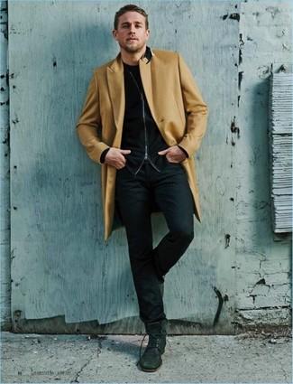 How to wear: black jeans, black crew-neck t-shirt, black zip sweater, camel overcoat