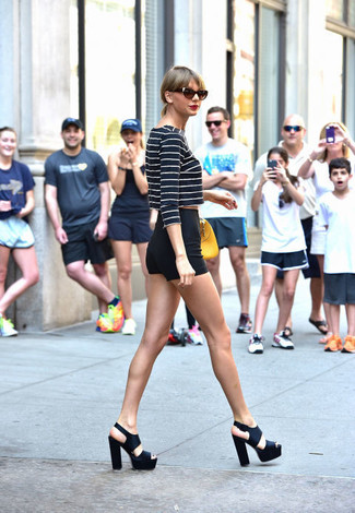 Taylor Swift wearing Navy and White Horizontal Striped Cropped Sweater, Black Shorts, Black Chunky Leather Heeled Sandals, Yellow Leather Handbag