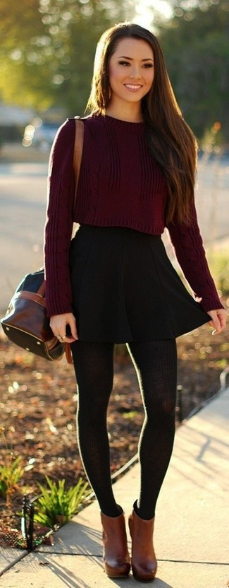 Try pairing a burgundy cropped sweater with a black pleated skirt for an easy to wear look. Play down the casualness of your outfit with brown leather booties. So when summer is over and autumn is taking over, you'll find this getup to be your everything.