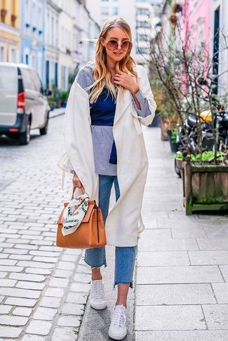 How to wear: blue jeans, blue cropped top, light blue chambray dress shirt, white lightweight trenchcoat