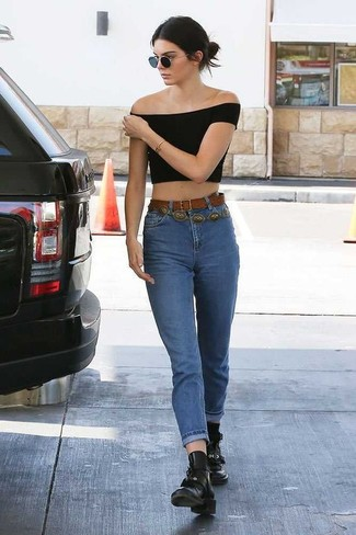 Kendall Jenner wearing Black Cropped Top, Blue Jeans, Black Leather Lace-up Flat Boots, Brown Leather Belt