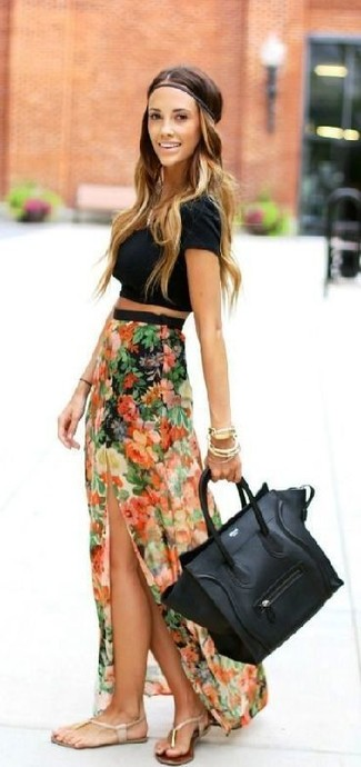 A black cropped top and a cream floral chiffon maxi skirt will give off this very sexy and chic vibe. Want to go easy on the shoe front? Go for a pair of cream leather thong sandals for the day. No doubt, it's easier to work through a blazing hot warm weather afternoon in a light and breezy look like this one.