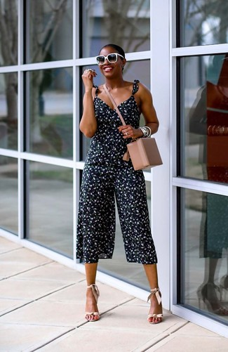 How to wear: black and white sunglasses, beige leather crossbody bag, beige leather heeled sandals, navy floral jumpsuit