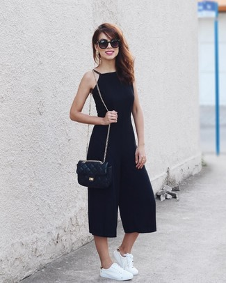 How to wear: black sunglasses, black quilted leather crossbody bag, white leather low top sneakers, black jumpsuit