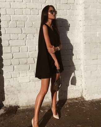 How to wear: dark brown sunglasses, black embellished leather crossbody bag, white leather pumps, black swing dress