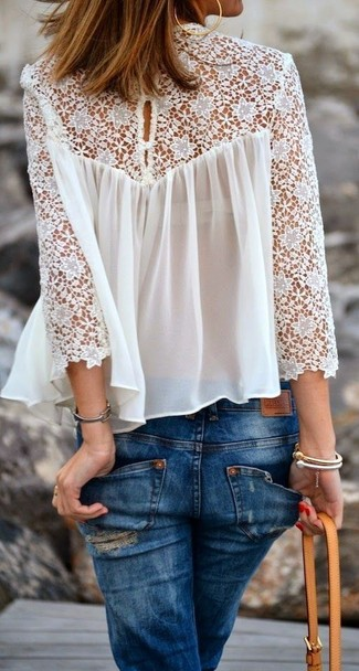 How to Wear a White Lace Long Sleeve Blouse: Demonstrate your outfit coordination expertise by wearing this casual combination of a white lace long sleeve blouse and blue ripped skinny jeans.