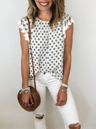 How to wear: white bracelet, brown straw crossbody bag, white ripped skinny jeans, white floral sleeveless top