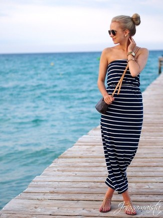 How to wear: black sunglasses, dark brown print leather crossbody bag, tan leather thong sandals, navy and white horizontal striped maxi dress