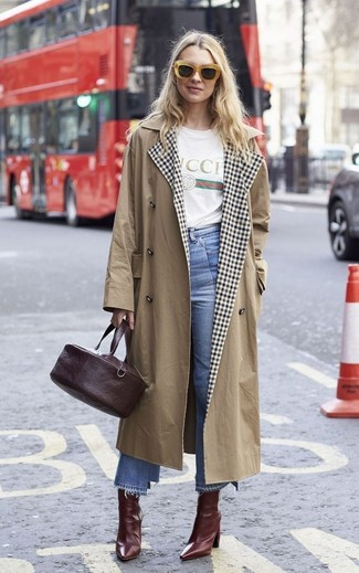 How to wear: burgundy leather ankle boots, light blue denim culottes, white print crew-neck t-shirt, tan trenchcoat