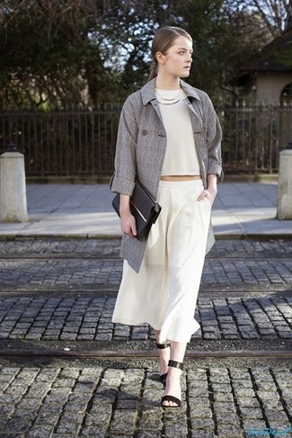How to wear: black leather heeled sandals, white culottes, white cropped top, grey trenchcoat