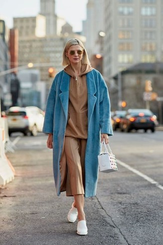How to wear: white leather mules, tan culottes, tan hoodie, aquamarine coat