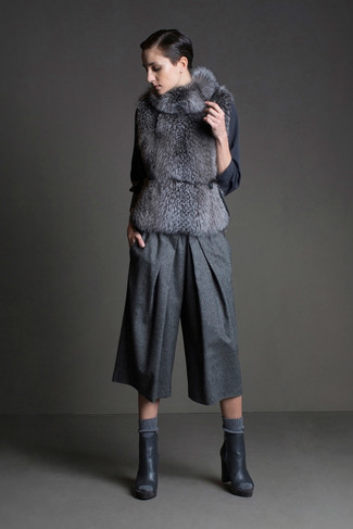 How to wear: charcoal cutout leather ankle boots, grey wool culottes, charcoal long sleeve blouse, grey fur vest