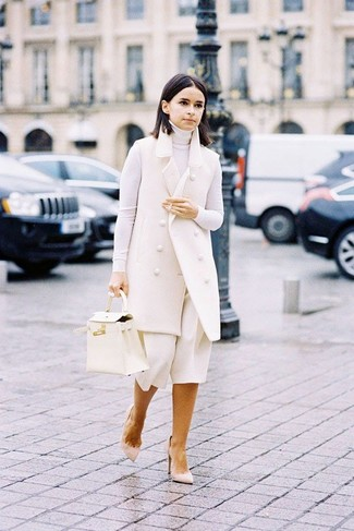 How to wear: beige suede pumps, white culottes, white turtleneck, white sleeveless coat