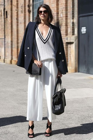 How to wear: black suede heeled sandals, white culottes, white and black v-neck sweater, black vertical striped double breasted blazer