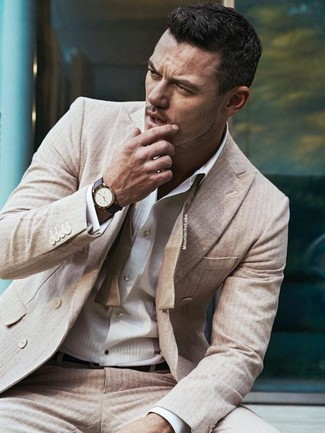 Wear a beige vertical striped suit with a white vertical striped dress shirt for rugged sophistication with a twist.