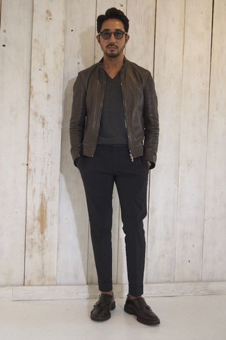 How to wear: dark brown leather bomber jacket, charcoal v-neck sweater, black chinos, dark brown leather double monks