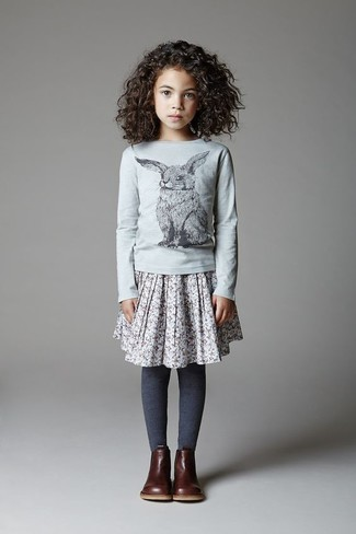 How to Wear a Grey Long Sleeve T-Shirt For Girls: Choose a grey long sleeve t-shirt and a grey skirt for your daughter to create a cool, stylish look. This ensemble is complemented brilliantly with dark brown boots.