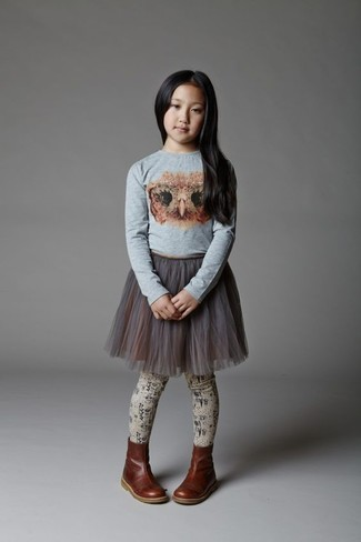 How to Wear a Grey Long Sleeve T-Shirt For Girls: Help your mini fashionista look fashionable by suggesting that she pair a grey long sleeve t-shirt with a grey tulle skirt. This ensemble is complemented wonderfully with dark brown leather boots.