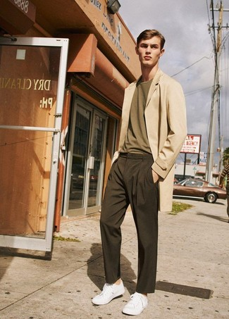 How to wear: white low top sneakers, dark brown chinos, olive crew-neck t-shirt, beige overcoat