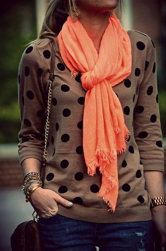 How to wear: orange scarf, dark brown leather crossbody bag, navy skinny jeans, brown polka dot crew-neck sweater