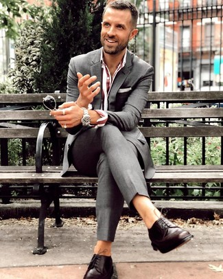 How to wear: silver watch, dark brown leather derby shoes, burgundy vertical striped dress shirt, charcoal suit