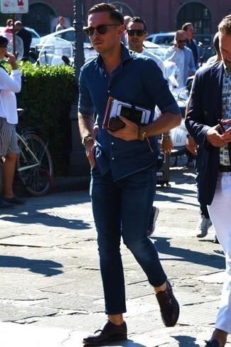 How to Wear a Blue Denim Shirt For Men: Such staples as a blue denim shirt and navy jeans are an easy way to introduce effortless cool into your casual routine. Kick up the dressiness of this outfit a bit by wearing dark brown leather double monks.