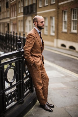 Men's Looks & Outfits: What To Wear In 2020: Try teaming a tobacco suit with a white dress shirt if you're going for a proper, stylish outfit. On the fence about how to finish? Complete this look with a pair of dark brown leather double monks for a more relaxed twist.