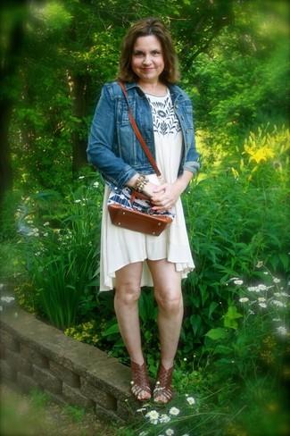 How to wear: multi colored bracelet, dark brown leather gladiator sandals, beige print swing dress, blue denim jacket