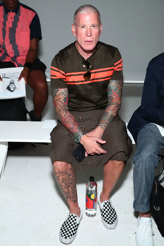 Nick Wooster wearing Dark Brown Horizontal Striped Crew-neck T-shirt, Brown Shorts, Black and White Check Canvas Slip-on Sneakers