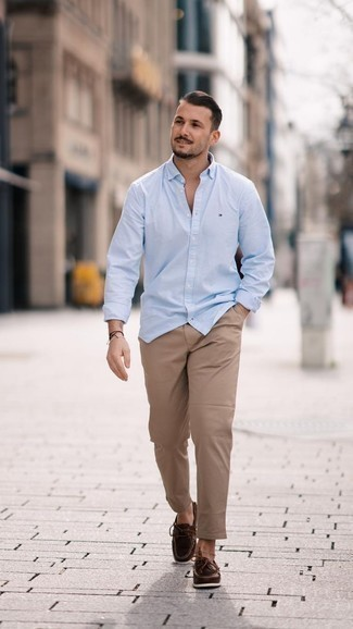 Men's Looks & Outfits: What To Wear In 2020: Why not try teaming a light blue long sleeve shirt with khaki chinos? Both pieces are super comfortable and look awesome when teamed together. If not sure as to what to wear on the shoe front, stick to dark brown leather boat shoes.