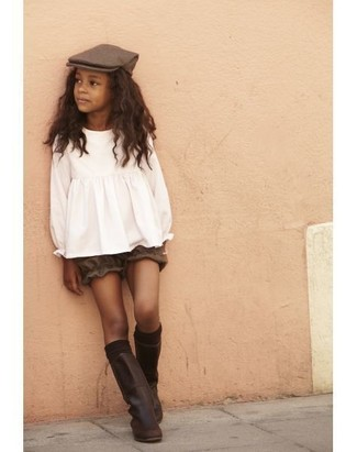 How to wear: dark brown leather boots, brown shorts, white long sleeve blouse