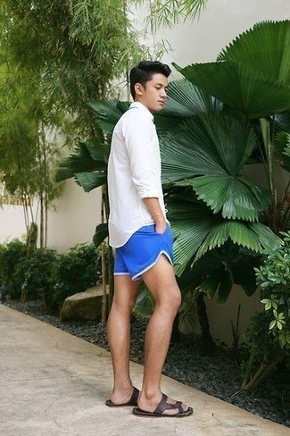 How to Wear Dark Brown Leather Sandals For Men: This pairing of a white long sleeve shirt and blue sports shorts is undeniable proof that a straightforward off-duty look can still be really dapper. Rev up the style factor of this ensemble by sporting a pair of dark brown leather sandals.