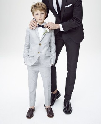 Boys' Looks & Outfits: What To Wear In 2020: Go for a classic style for your darling with a grey suit and a white long sleeve shirt. This ensemble is complemented perfectly with dark brown loafers.