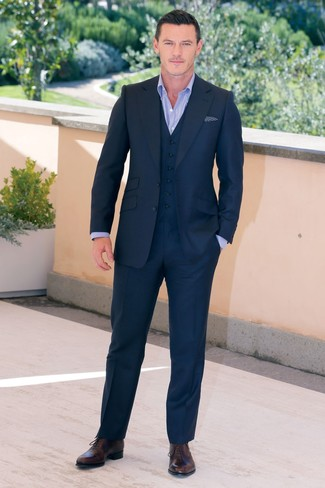 A navy three piece suit looks especially refined when married with a light blue dress shirt in a modern man's look. The whole outfit comes together when you complement this outfit with dark brown leather oxford shoes.