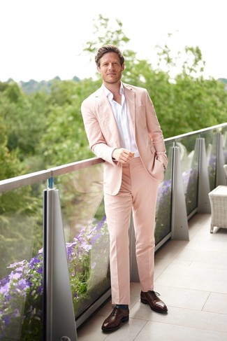 How to wear: teal socks, dark brown leather oxford shoes, white long sleeve shirt, pink suit
