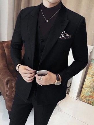 How to Wear a Black Three Piece Suit: This combo of a black three piece suit and a dark brown turtleneck is perfect when you need to look sophisticated and incredibly stylish.