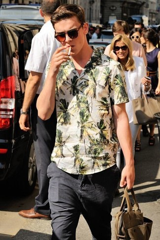How to wear: dark brown sunglasses, black jeans, white floral short sleeve shirt