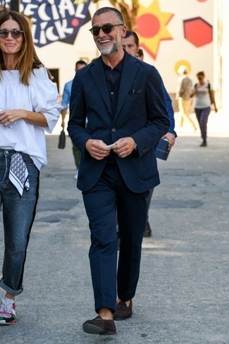 How to Wear a Black Long Sleeve Shirt For Men: The combo of a black long sleeve shirt and a navy vertical striped suit makes this a really pulled together getup. And if you wish to easily spruce up your ensemble with one single piece, introduce a pair of dark brown suede tassel loafers to the mix.
