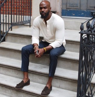 How to wear: yellow bracelet, dark brown suede tassel loafers, navy dress pants, white henley sweater