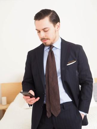 How to wear: white pocket square, dark brown tie, light blue dress shirt, black vertical striped suit